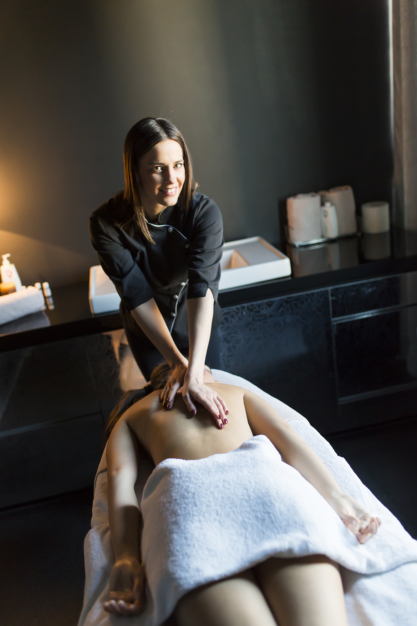 massage therapy student smiling during work